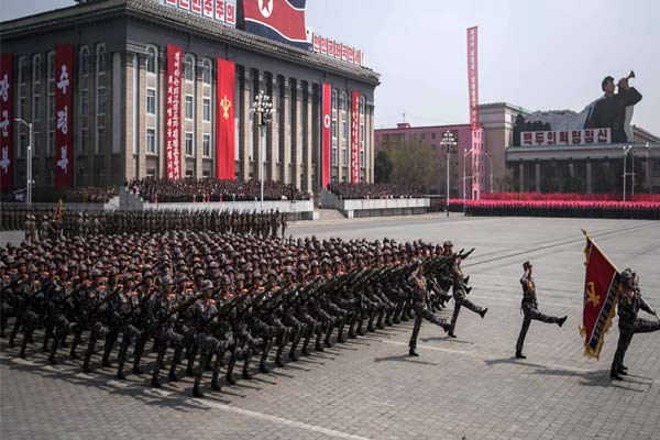North Korea defies coronavirus appears to have held huge military parade Seoul
