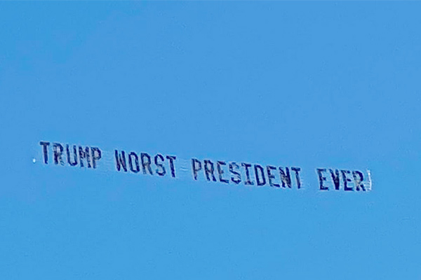 The banner waved in the sky in Florida wrote The worst presidential trump ever