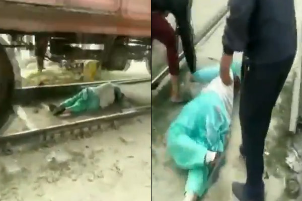 Woman saved her life by lying down on a railway track in Haryana's Rohtak after she got trapped