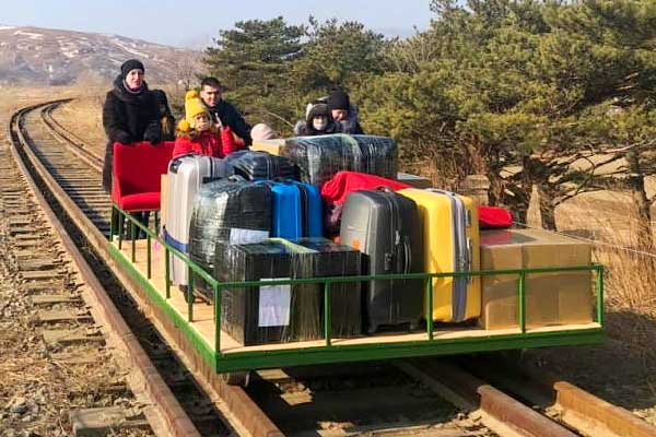 Russian diplomats returning on Rail trolley